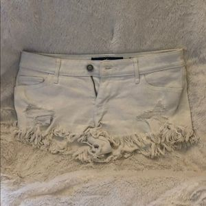 White Hollister Short Shorts with rips and frays